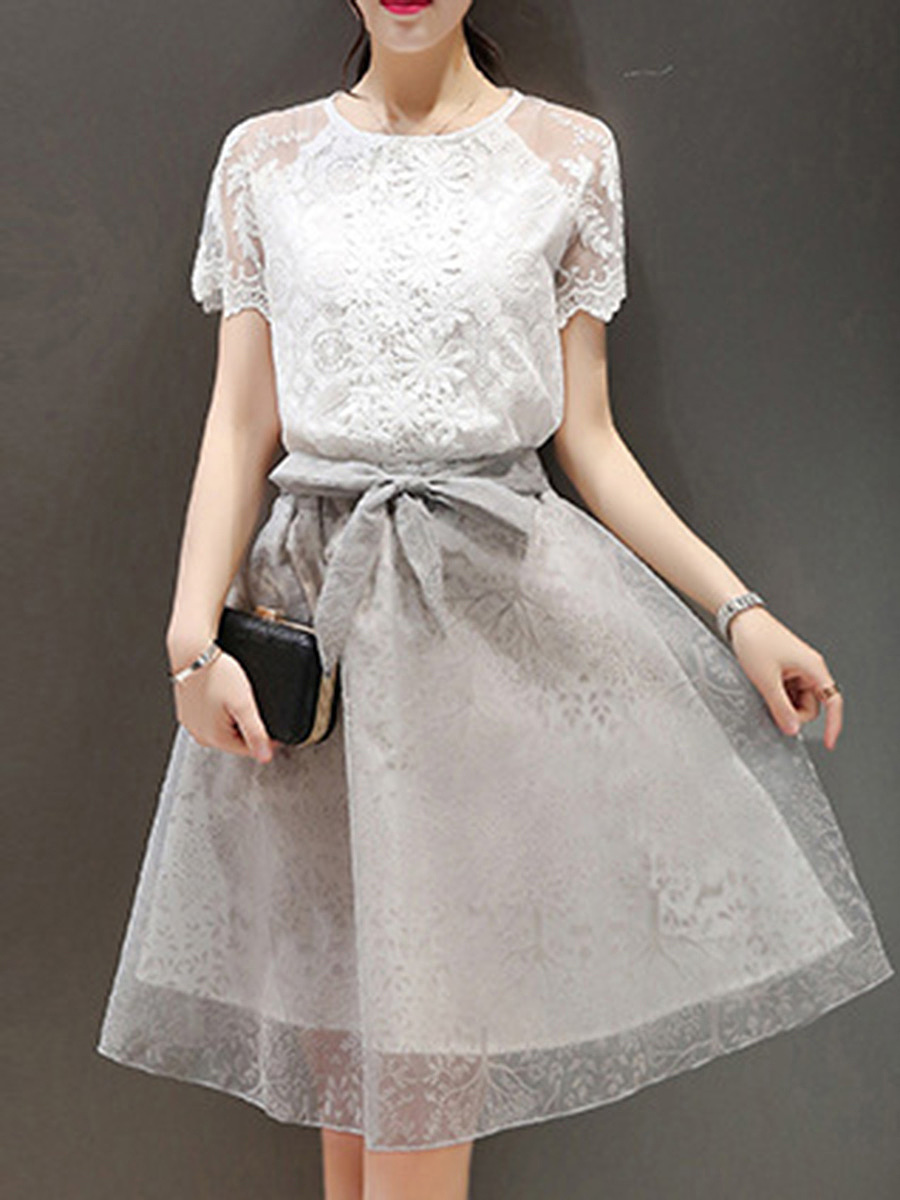 Round Neck Hollow Out Blouse And Bowknot Flared Skirt