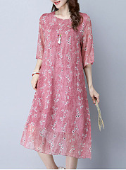 Captivating-Hollow-Out-Printed-Round-Neck-Midi-Shift-Dress