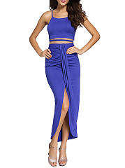 Attractive Spaghetti Strap Plain Crop Top And Slit Skirt