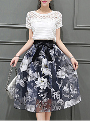 Hollow Out T-Shirt And Floral Printed Flared Midi Skirt