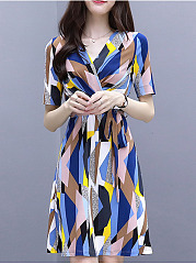 Surplice  Ruffled Hem  Belt Belt Loops  Color Block Geometric Printed Skater Dress