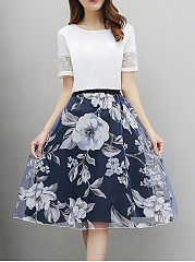 Round-Neck-Hollow-Out-T-Shirt-And-Floral-Printed-Flared-Skirt