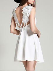Wing Spaghetti Strap Plain Mini Skater Dress