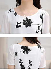Floral Embroidery Asymmetric Hem Round Neck Blouse