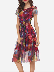 Bowknot Round Neck Printed Hollow Out Skater Dress