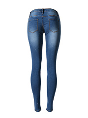 Ripped  Light Wash  Slim-Leg  Mid-Rise Jeans